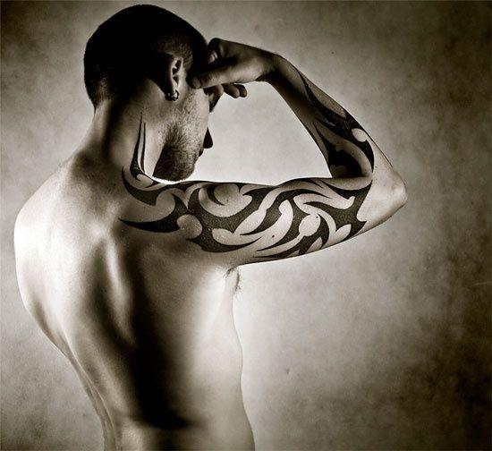 tatouage tribal homme : 15 photos de tatouage homme tribal - photos